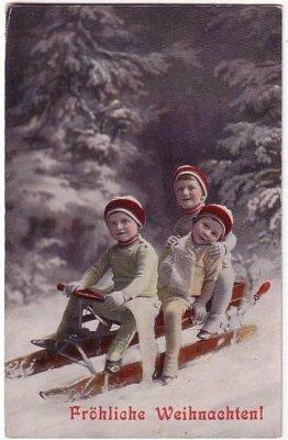 Ansichtskarte Fröhliche Weihnachten Kinder mit Schlitten