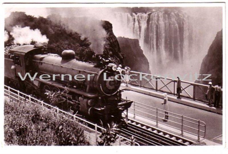 Postcard A Rhodesian Railways train crossing the Victoria Falls Bridge