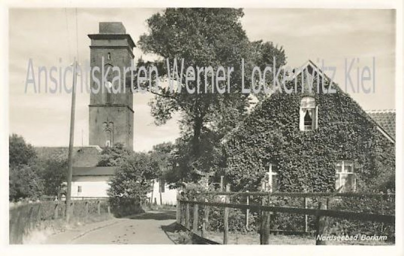 Ansichtskarte Borkum Ortsstraße mit altem Leuchtturm