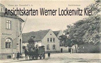 Ansichtskarte Staßfurt-Neundorf Stassfurterstrasse mit Postamt